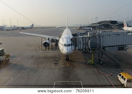 HONG KONG - APRIL 17: jet aircraft docked in airport on April 17, 2014 in Hong Kong. Hong Kong International Airport  is one of the best airport in the annual passenger survey by Skytrax.