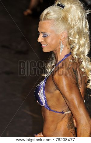 Female Fitness Contestant Showing Her Best