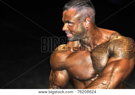 Male Bodybuilding Contestantdoing A Chest Pose