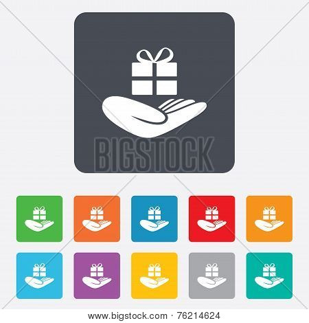 Give a gift sign. Hand holds present box.