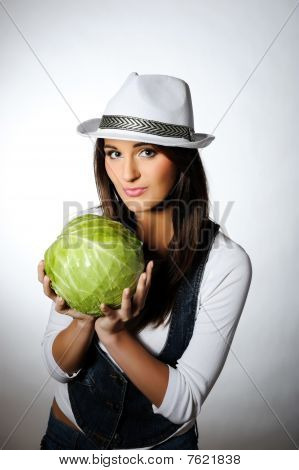 Young Pretty Woman With Green Beautiful Cabbage