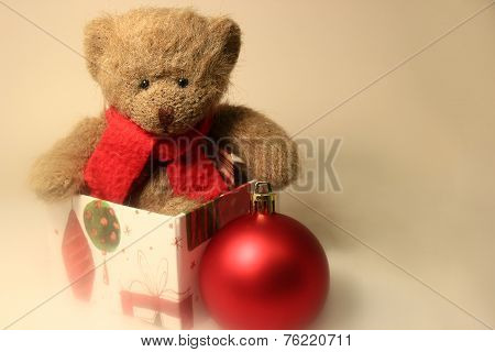Teddy Bear Sitting A Gift Box