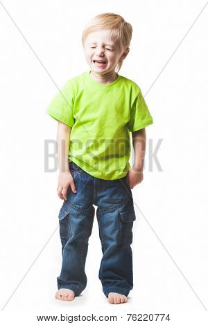 Blonde boy, 4 years old, full-length portrait, without shoes. Uniform light gray background.