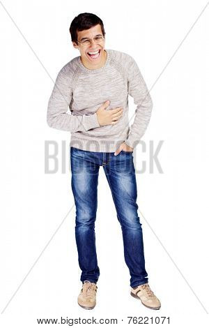 Full length portrait of young man in glasses and beige sweater doubling up with laughter isolated on white background