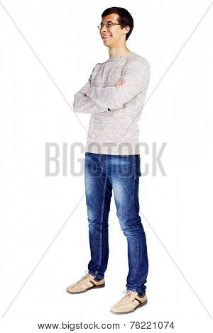 Full length half turn view portrait of smiling young man in glasses and beige sweater with crossed arms on his chest isolated on white background
