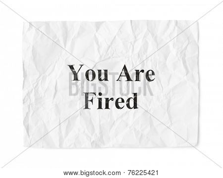 Crumpled paper You Are Fired isolated on white background