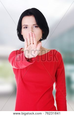 Confident woman stop gesture sing with hand