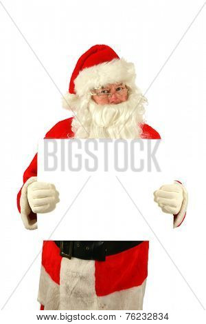 Santa Claus holds and points to a white blank sign with smile, isolated on white with room for your text. Santa Claus wants to help you sell your product or service with this image. Santa is like that