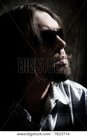 Long Hair Man In A Low Key Shot