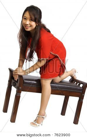 Woman Sitting On Chair Wearing Red Dress