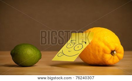 Lemon with sticky post-it note showing tongue to lime
