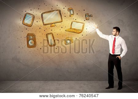 Man throwing hand drawn technologyl devices concept
