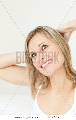 Happy Woman Stretching On Her Bed