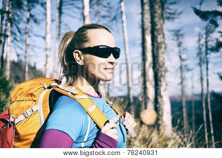 Woman Hiking In Winter Autumn Forest