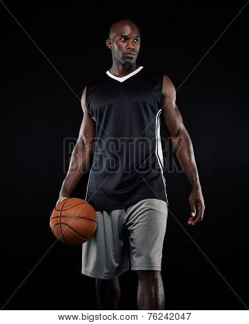 Portrait Of Basketball Player On Black Background