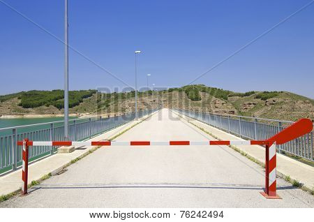 Safety barrier at a dam production of electrical energy.