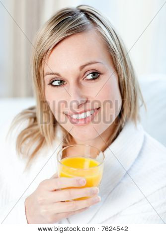 Portrait Of A Charming Woman Holding An Orange Juice