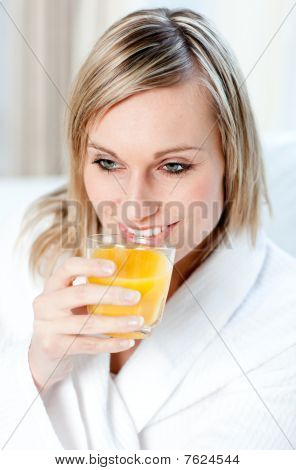 Portrait Of A Young Woman Holding An Orange Juice