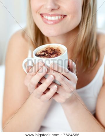 Portrait Of A Smiling Woman Drinking A Coffee