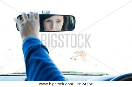 Caucasian Woman Looking In The Rear-view Mirror