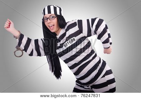 Prisoner in striped uniform on white
