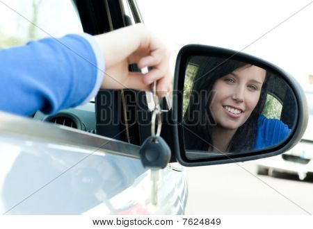 Cheerful Teen Girl Sitting In Her Car Holding Keys