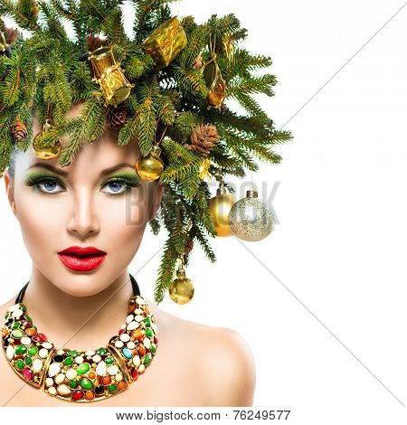 Christmas Woman. Beautiful New Year and Christmas Tree Holiday Hairstyle and Make up. Beauty Girl Portrait isolated on a White Background. Colorful Makeup and Hair