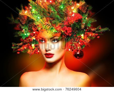 Christmas Winter Fashion Model Girl with Christmas tree hairstyle decorated with garland lights and baubles. make up. Beauty Woman. Beautiful New Year Holiday Creative Hair style