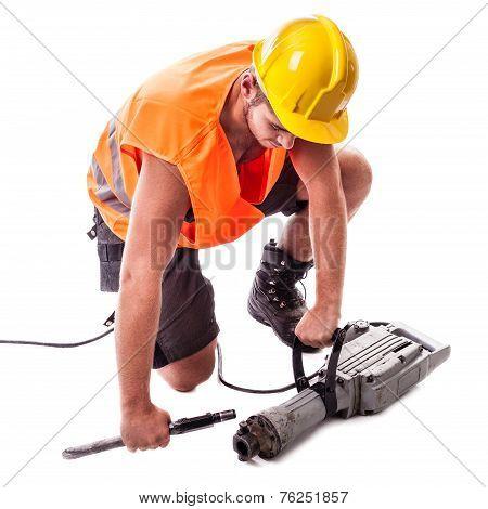 Worker Assembling A Jackhammer