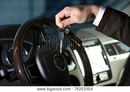 Man with car key