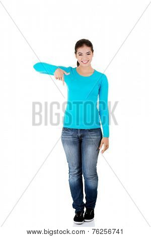 Full length woman pointing down.
