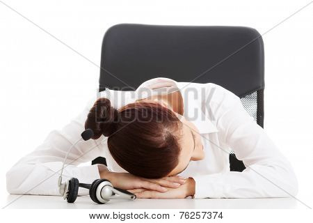 Call center woman taking nap on a desk.
