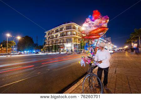 Vendor Selling Balloons At Evening Phnom Penh, Cambodia