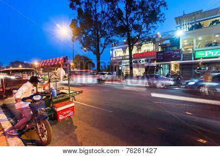 Vendor Selling Food At Evening Asian City. Phnom Penh, Cambodia