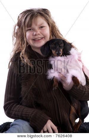 Girl Holding Dog