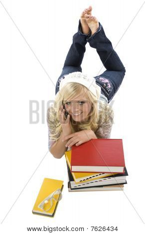 Girl Laying Behind Books On Phone