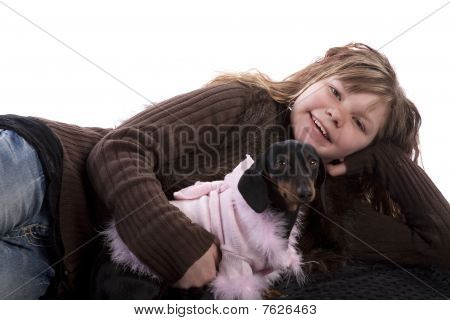 Girl Laying By Dog