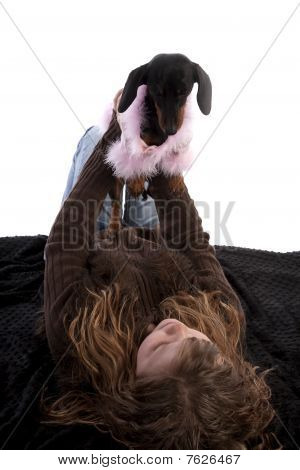 Girl Laying On Back With Dog