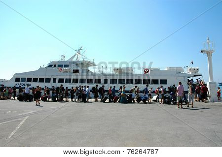 Tourists Board The Catamaran