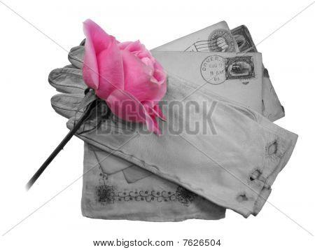antique mementos and pink rose