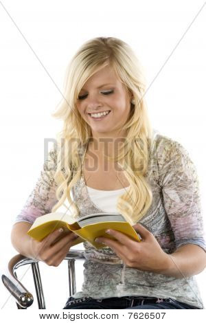 Girl Reading Yellow Book Looking Down