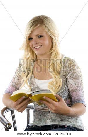 Girl Reading Yellow Book.