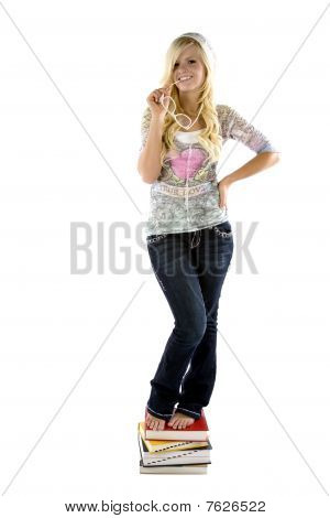 Girl Standing On Books Glasses In Mouth
