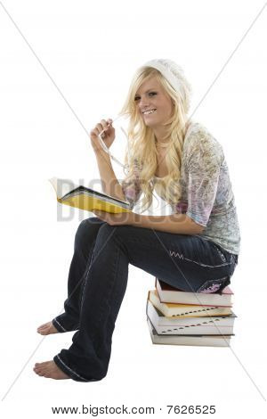 Girl With Book Sitting On Books.