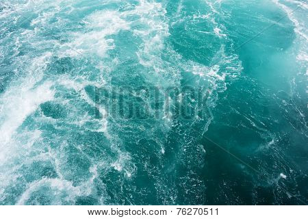 White Wake On The Blue Ocean