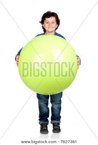 Child Holding A Pilates Ball