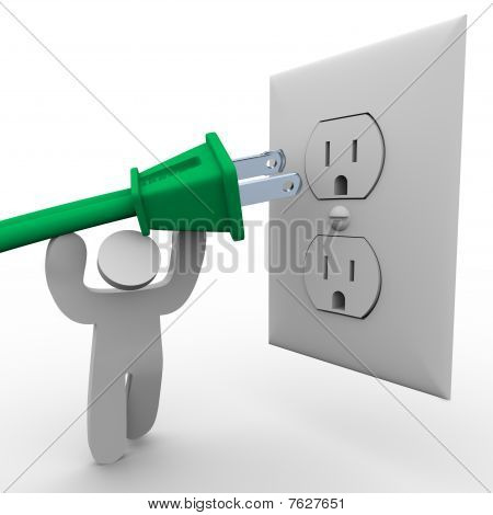 Person Lifting Power Plug To Electrical Outlet