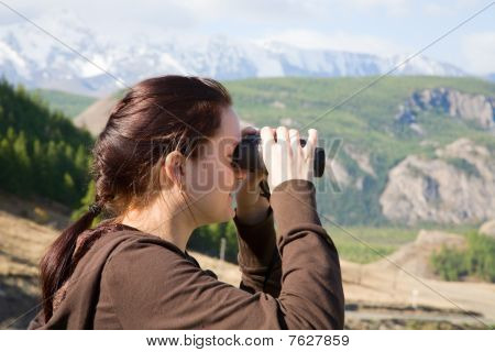 Young Women Looking Through Binocular