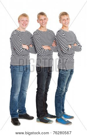 Handsome boys in a striped shirts with arms crossed. Two of the boys twin brothers.