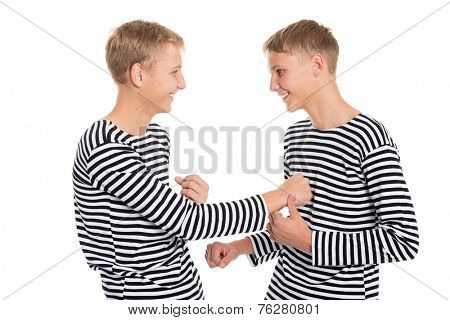 Twin brothers playing a joke with each other. Boys at the age of eighteen.